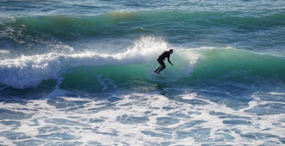 Surfer at Crystal Cove