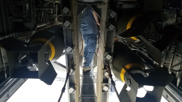 Jim squeezing through b-24 bomb bay